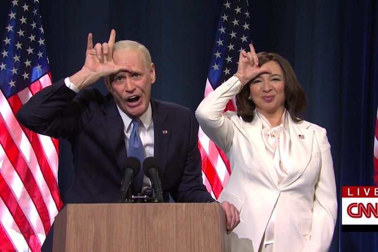 Jim Carrey as Joe Biden and Maya Rudolph as Kamala Harris both put their hands to their foreheads in the shape of an