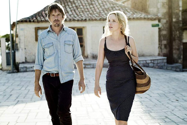Ethan Hawke and Julie Delpy face the camera in a sun-drenched square.