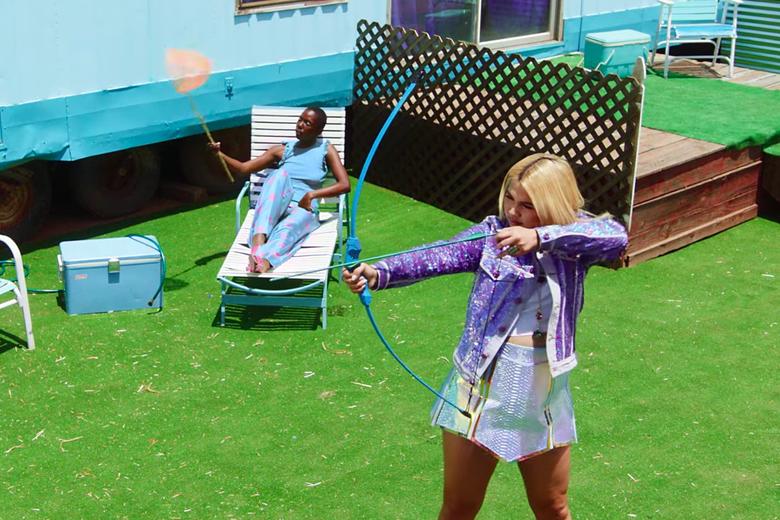 Hayley Kiyoko readies her bow.