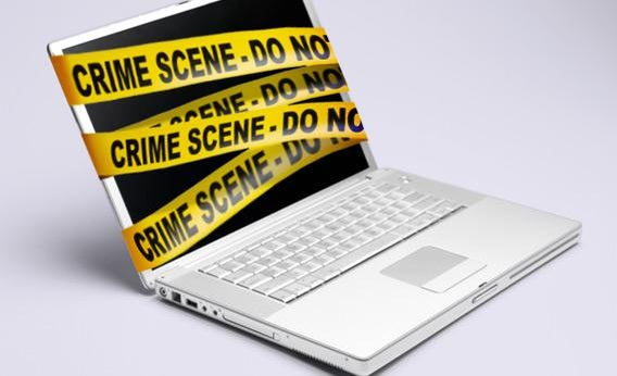 Computer with police tape.