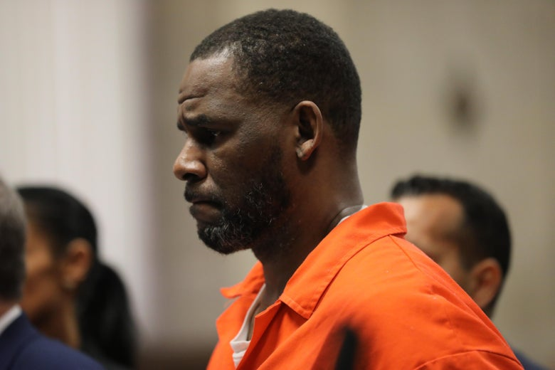 R. Kelly wearing an orange prison jumpsuit.
