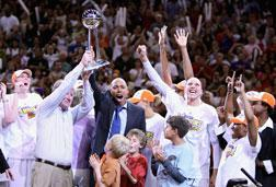 Members of the Phoenix Mercury celebrate with the WNBA trophy. Click image to expand.