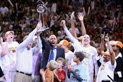 Members of the Phoenix Mercury celebrate with the WNBA trophy.