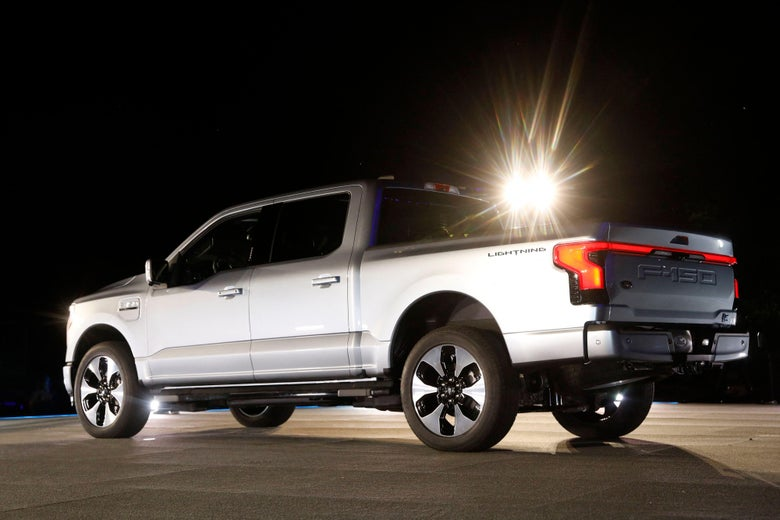 A silver Ford F-150 electric pickup truck.
