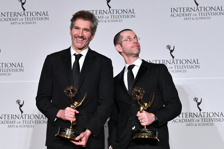 David Benioff and D.B. Weiss hold Emmy awards.