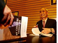 Dr. Wen Ho Lee at a book signing in 2002          Click image to expand.