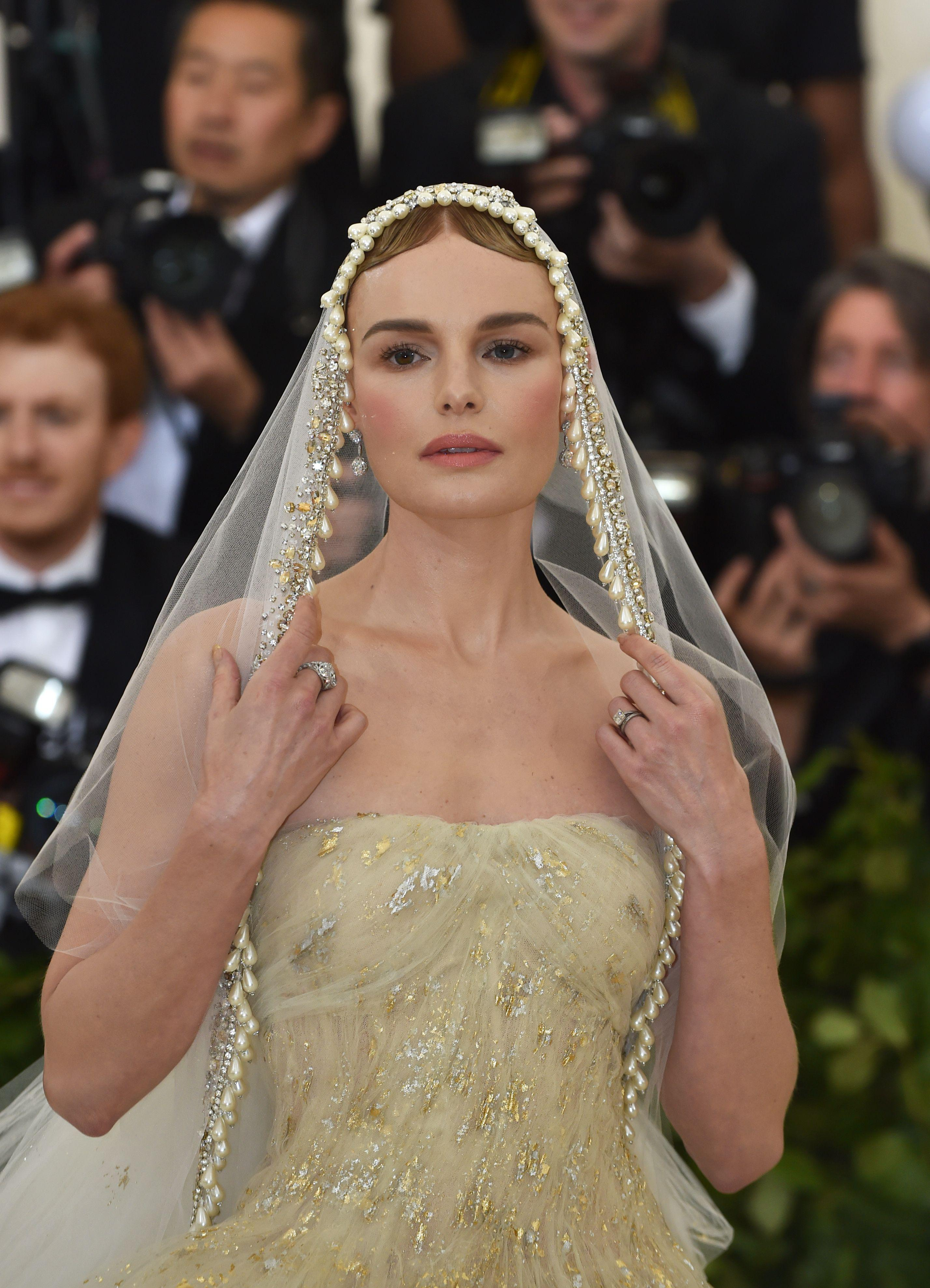 Kate Bosworth arrives for the 2018 Met Gala on May 7, 2018, at the Metropolitan Museum of Art in New York. - The Gala raises money for the Metropolitan Museum of Arts Costume Institute. The Gala's 2018 theme is Heavenly Bodies: Fashion and the Catholic Imagination. (Photo by Hector RETAMAL / AFP)        (Photo credit should read HECTOR RETAMAL/AFP/Getty Images)