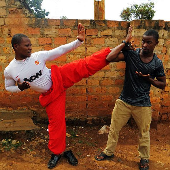 Ugandan martial artists, brothers Kuraisn Baale and Muhammad Khassim Jumba, in Katwe slum, Kampala. Primary story characters. Favourite photo. Photo by: Elizabeth McSheffrey