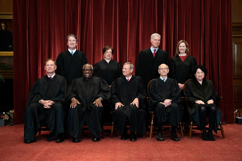 The Supreme Court justices pose for their group photo.