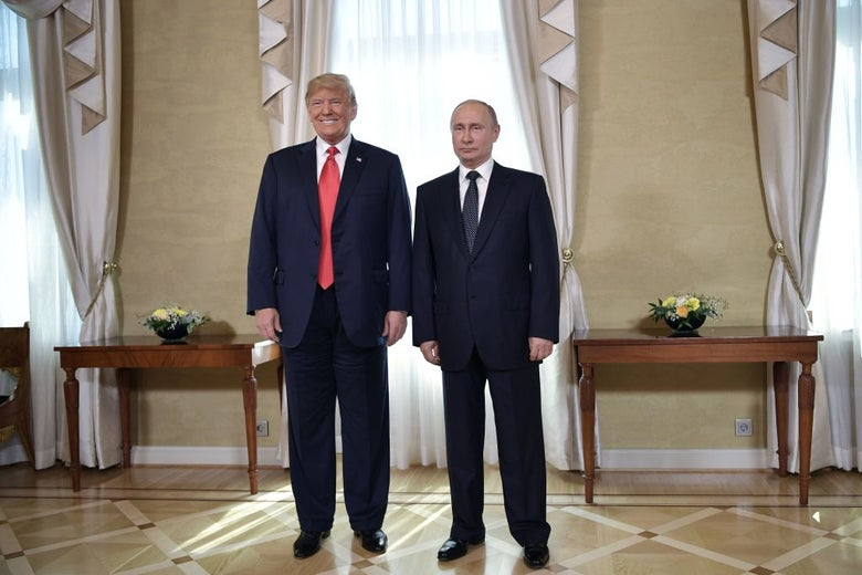 Trump and Putin stand somewhat awkwardly side-by-side in a formal reception hall.