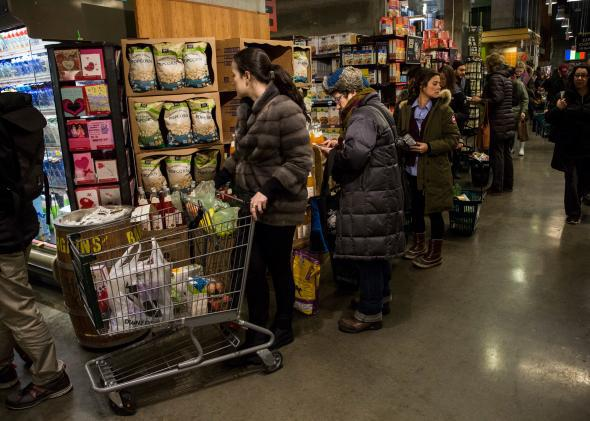 New Yorkers wait in a long line at Whole Foods as a major snowstorm begins on Jan. 26, 2015 in New York City.