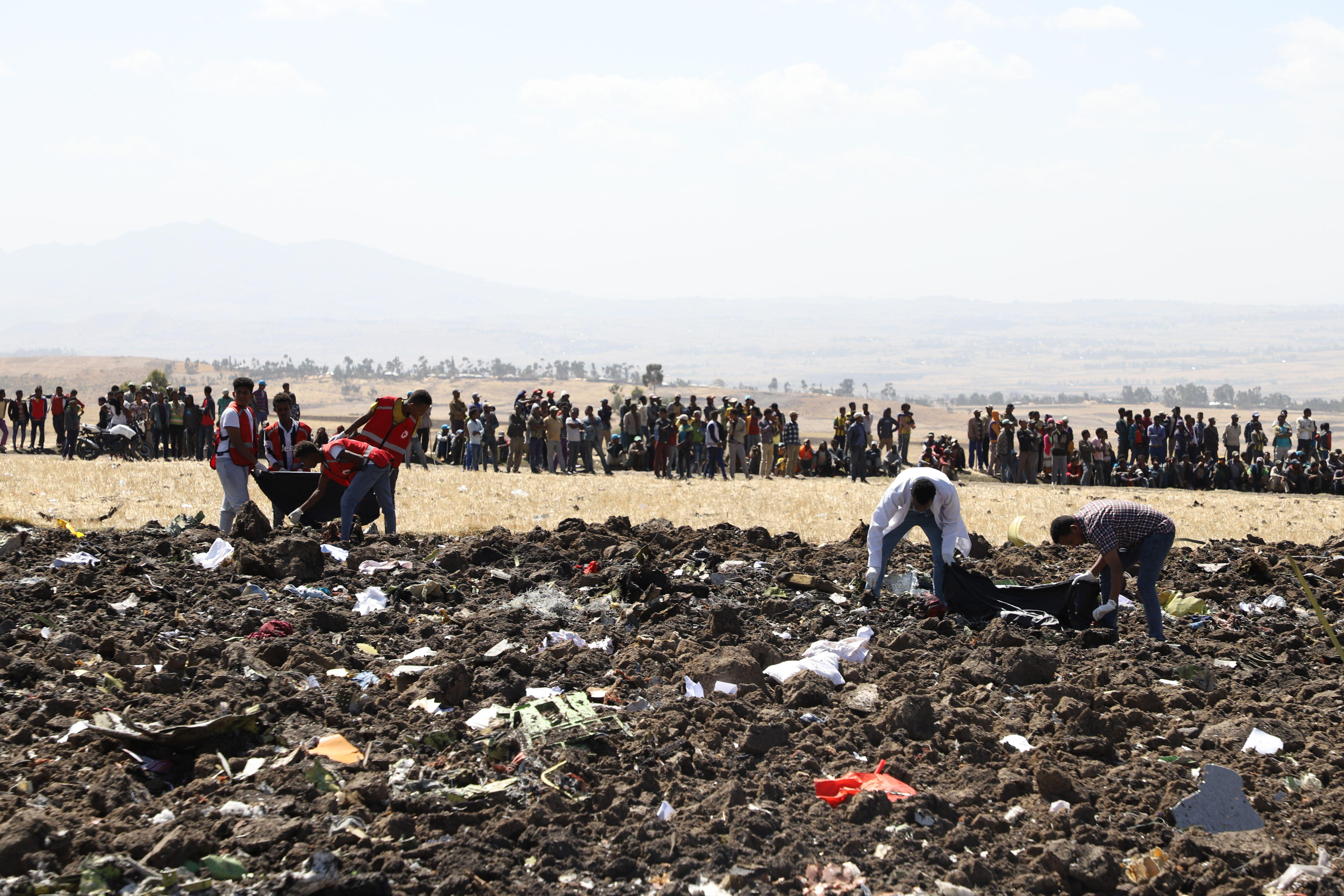 Rescue team collect remains of bodies amid debris at the crash site of Ethiopia Airlines near Bishoftu, a town southeast of Addis Ababa, Ethiopia, on March 10, 2019.