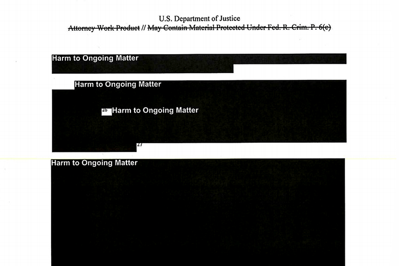 "Image of a heavily redacted page from the Mueller report: Most of the page is blacked out with the note ""Harm to Ongoing Matter."" The only visible report text is two citations, Nos. 26 and 27."