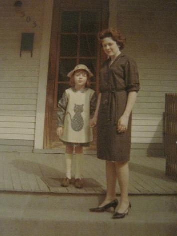 1966. She made my dress and cat pinafore, and she probably made her dress too.