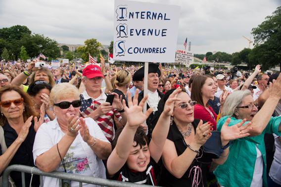 The crowd cheers for Rep. Michele Bachmann, R-Minn., during a Tea Party Patriots rally on the west front of the Capitol to protest the IRS's targeting of conservative political groups.