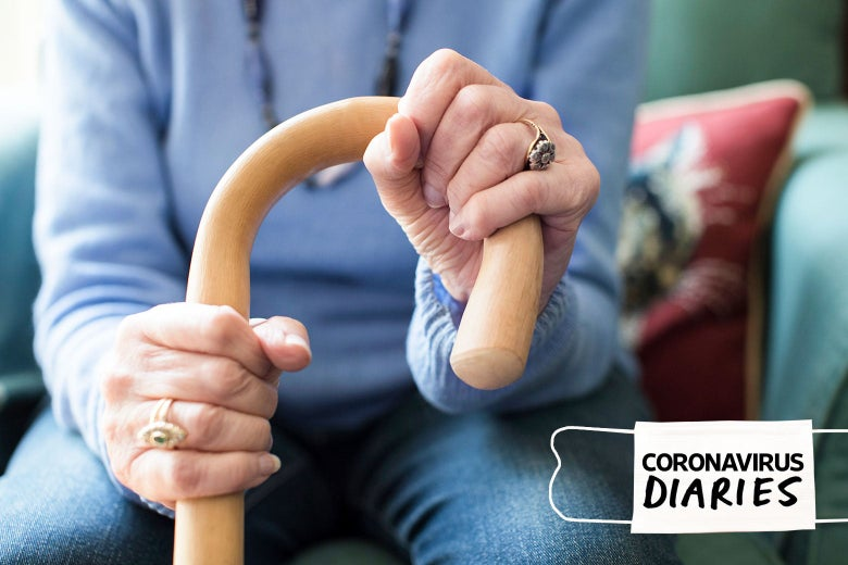 An old woman's hands, holding a cane.