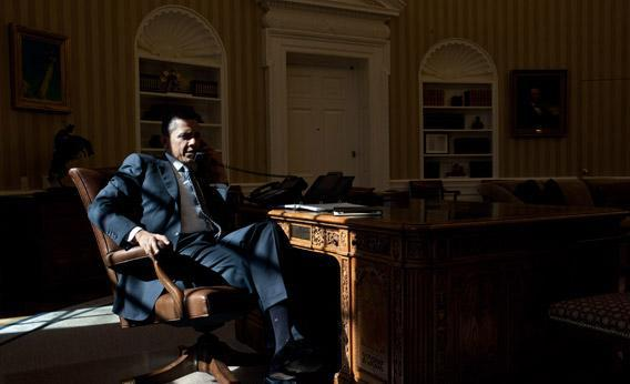 President Barack Obama talks on the phone in the Oval Office, Feb. 13, 2012
