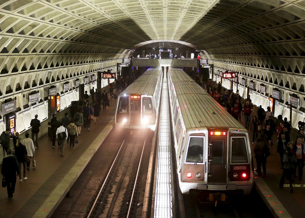 Metro trains arrive in the Gallery Place-Chinatown station ahead of a 29-hour shutdown for an emergency safety investigation of power cabling of the entire Washington Metro system in Washington March 15, 2016.