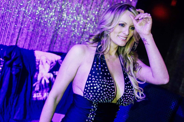 Stephanie Clifford, also known as Stormy Daniels, poses for pictures at the end of her striptease show in Gossip Gentleman club in Long Island, New York on Feb. 23.