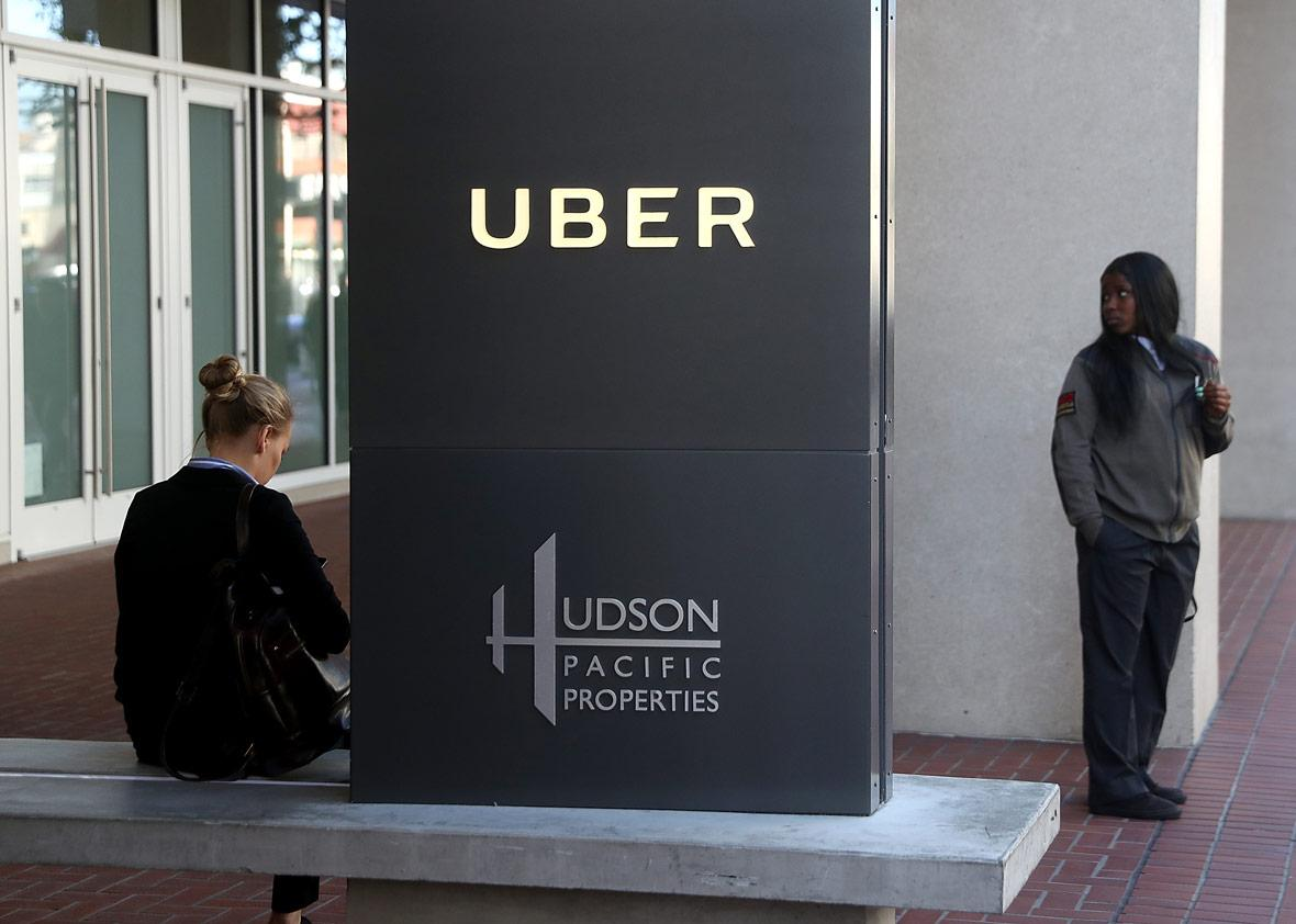 A private security guard stands in front of Uber headquarters