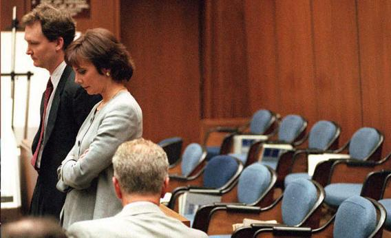 Prosecutors Hank Goldberg (L) and Marcia Clark (R) stand next to the empty jury box