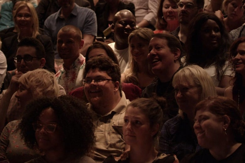 A theatrical audience. Tituss Burgess is a few rows behind Gavin Grimm.