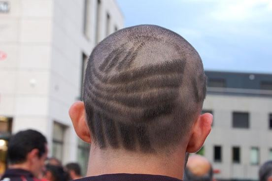 An Andorran athlete with the LieGames logo shaved in his hair.