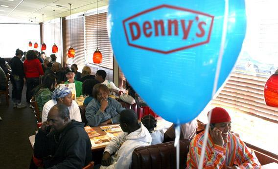 Customers fill the seats of a Denny's restaurant to receive a free Grand Slam breakfast.,56634833