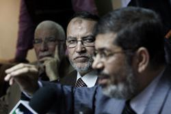 Muslim Brotherhood spokespersons Essam el-Arian (center) and Mohammed Mursi (right). Click image to expand.
