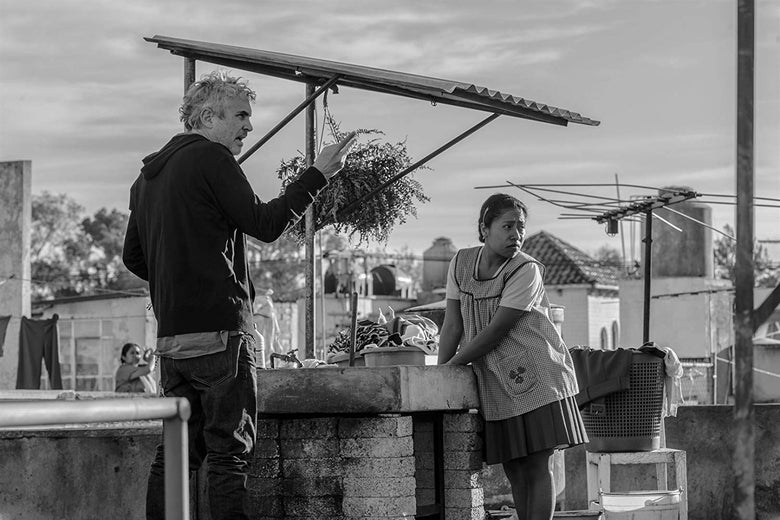 Alfonso Cuarón directs Yalitza Aparicio as Cleo on the set of Roma.