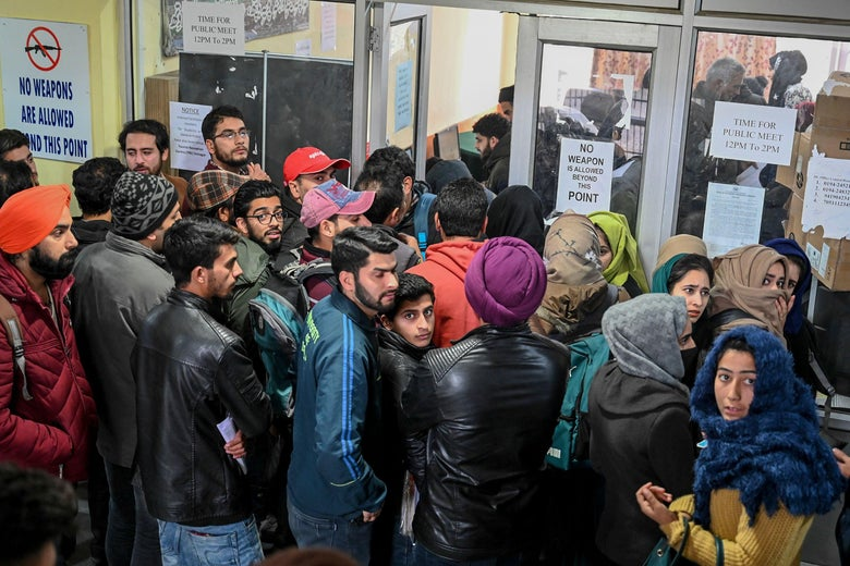 A crowd of students waiting in an office
