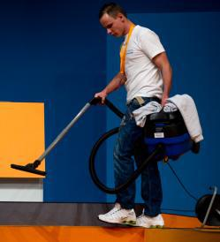 Man vacuuming.