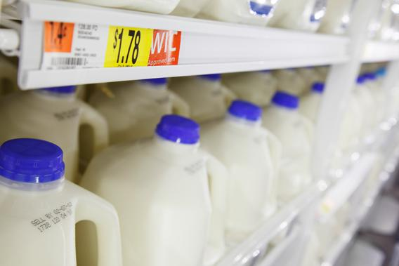 Gallons of milk in the dairy products section can be seen on display at a new Wal-Mart store in Chicago, January 24, 2012.