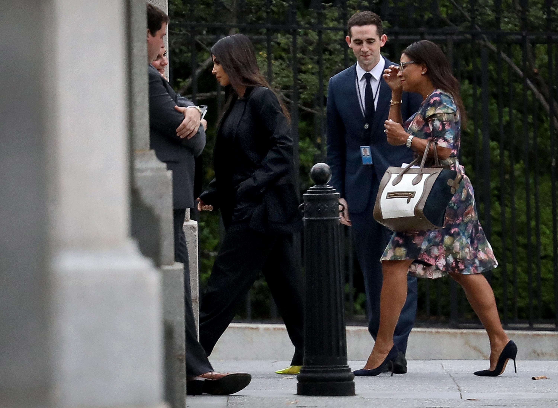 Kim Kardashian and entourage walk into White House grounds .