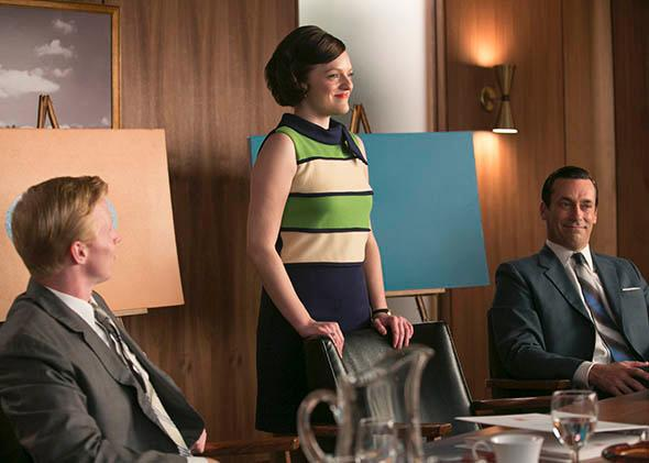 Elisabeth Moss as Peggy Olson and Jon Hamm as Don Draper in Mad Men.