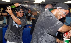 Tampa Bay Rays pitcher Joel Peralta celebrates with Champagne