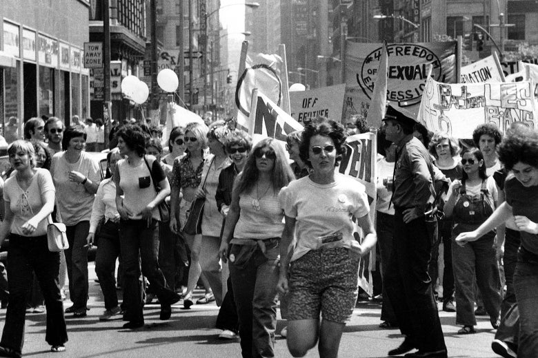 People march on the street for a gay liberation parade.