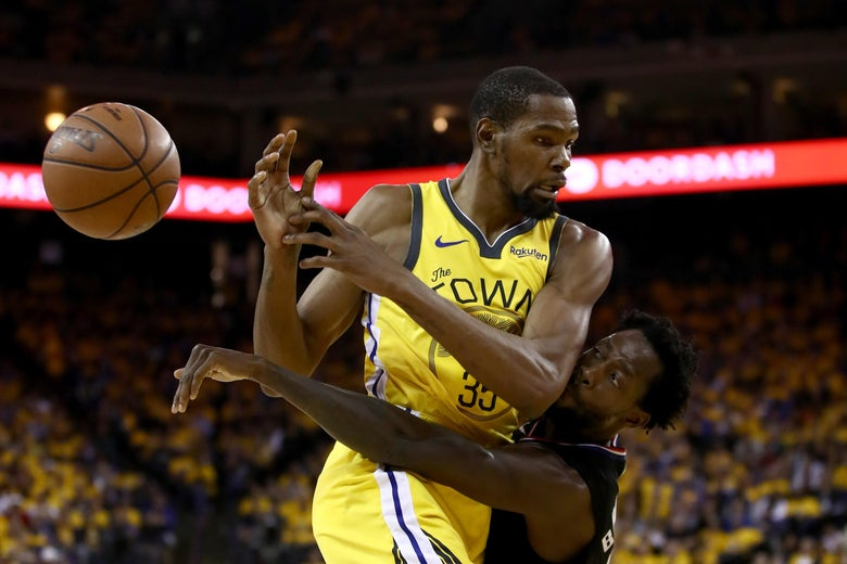 Kevin Durant and Patrick Beverley collide. The ball shoots out to the left.
