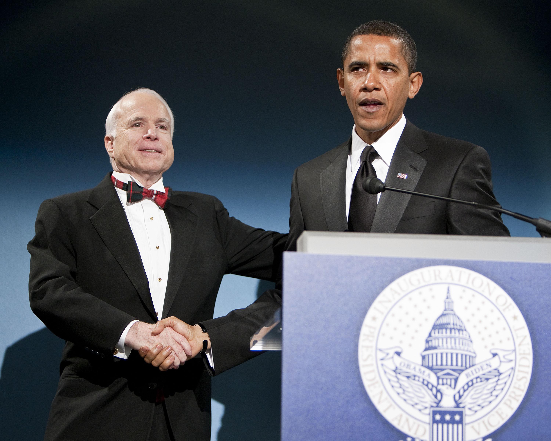 John McCain and Barack Obama share a handshake