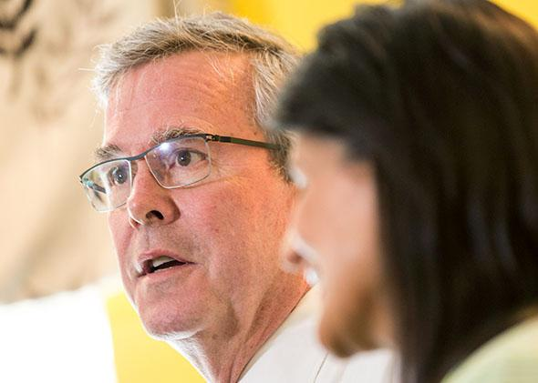 Jeb Bush answers a question as South Carolina Gov. Nikki Haley looks on during a stop in Columbia, South Carolina, on March 17, 2015.