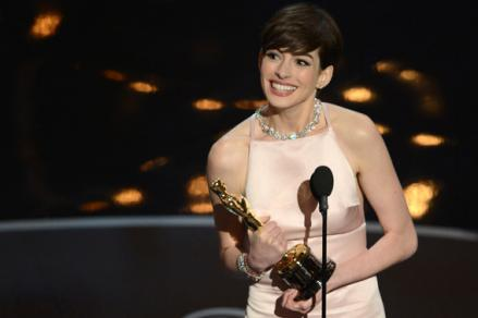 Best Supporting Actress winner Anne Hathaway addresses the audience onstage at the 85th Annual Academy Awards.