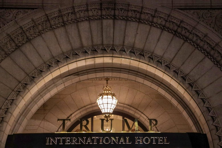 A sign that says Trump International Hotel.