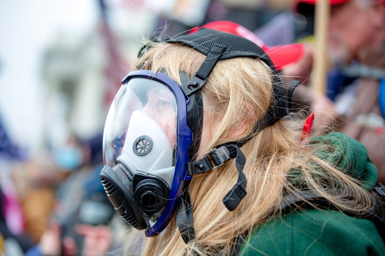A woman in a gas mask at the Save America March in D.C.