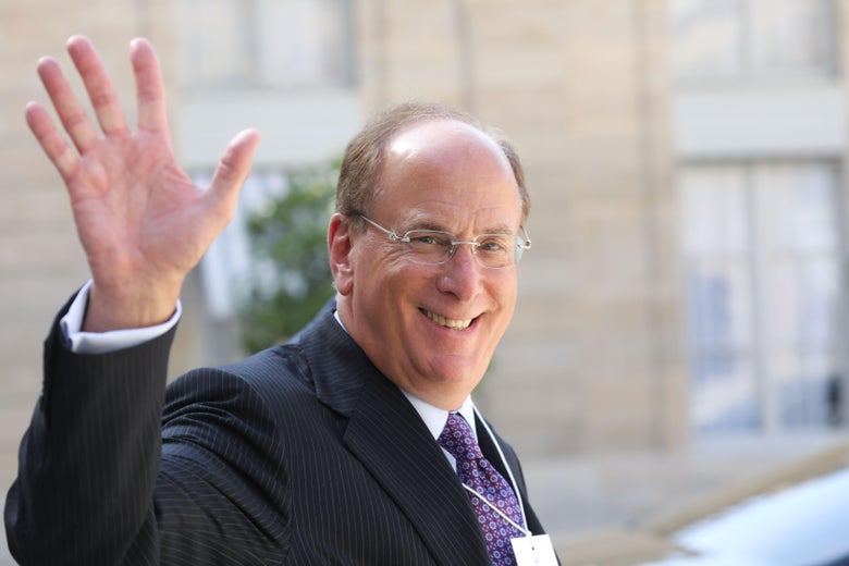 Chairman and CEO of BlackRock Larry Fink  waves as he leaves Elysee Palace.