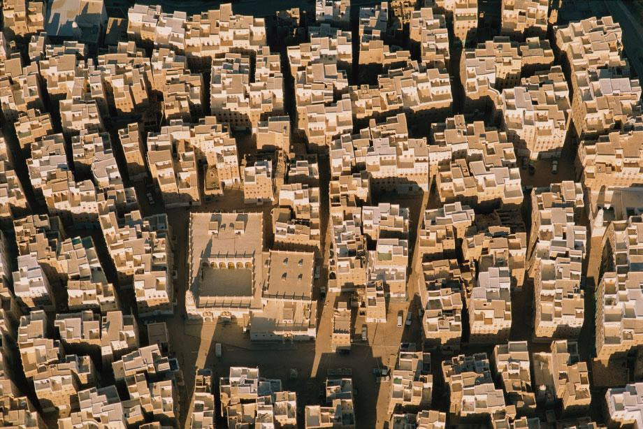 Shibam, Yemen. This ancient trading capital of the Empty Quarter is composed of seven-story mud-and-palm-wood towerhomes built close together to keep the streets and exterior walls cool and shaded for most of the day.