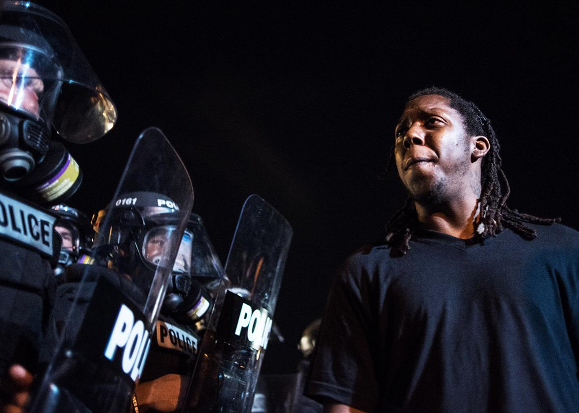 Police officers face off with protestors on the I-85 during protests following the death of a man shot by a police officer on September 21, 2016 in Charlotte, NC.