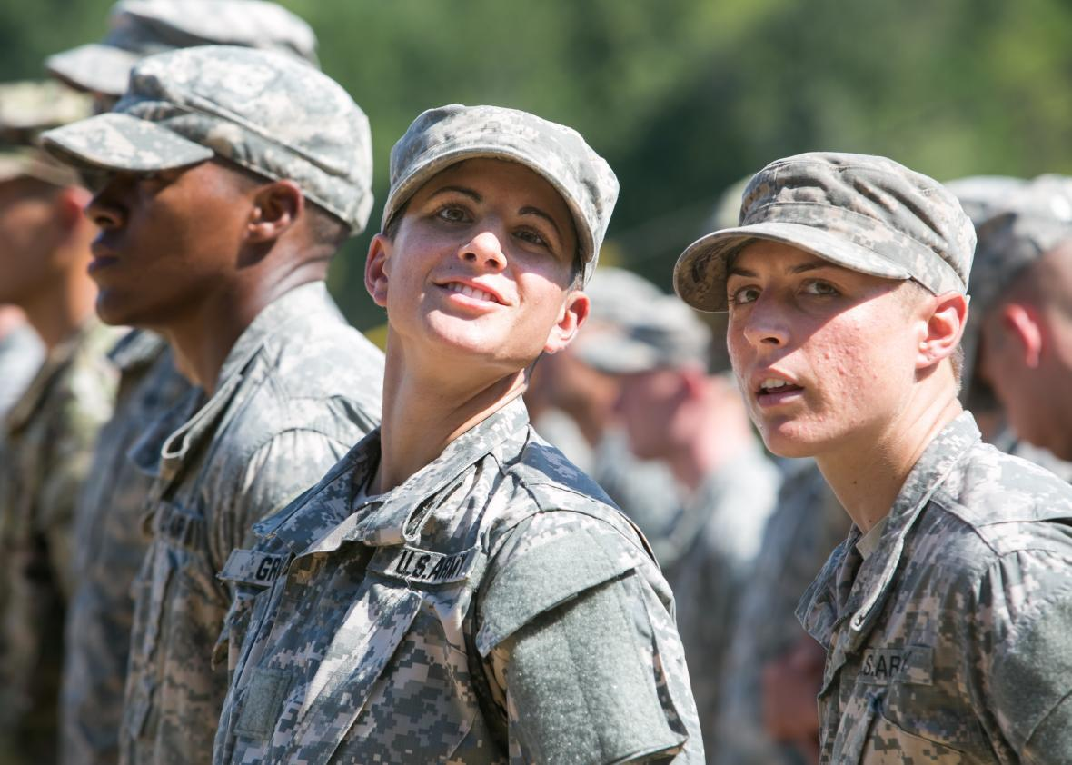 Capt. Kristen Griest (left) and 1st Lt. Shaye Haver look on during the graduation ceremony of the United States Army's Ranger School on Aug. 21, 2015, at Fort Benning, Georgia.