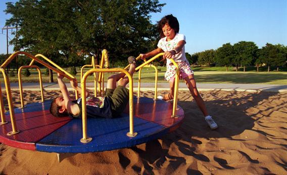 Children in Midland, Texas play in Cowden Park, September 4, 2000.