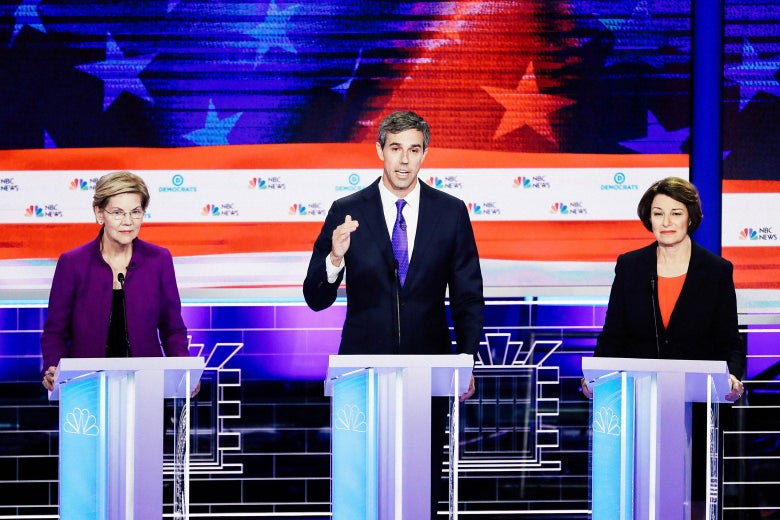 Elizabeth Warren, Beto O'Rourke, and Amy Klobuchar on the debate stage.