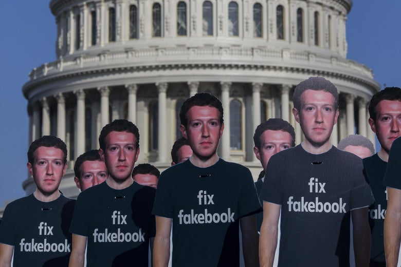 100 life-sized cutouts of Facebook CEO Mark Zuckerberg sit on the lawn of the U.S. Capitol ahead of Zuckerberg's hearing before the Senate Commerce, Science, and Transportation and Senate Judiciary Comittees.